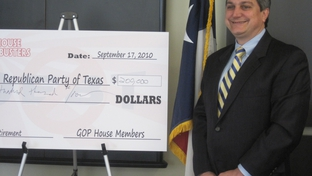 Steve Munisteri receives Debt Busters check.