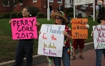 Protestors outside Gov. Perry's Derry NH Town Hall