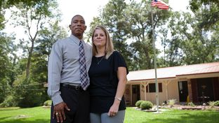 Rodney Pearson and his wife, Sandy, in front of their home in Jasper on June 15, 2012.