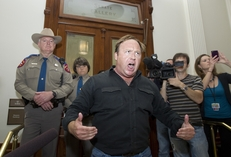 Talk show host and activist Alex Jones screams to the crowd outside the Senate gallery after being denied entrance during a rowdy protest of HB1937 the 'anti-groping' legislation on May 25, 2011.