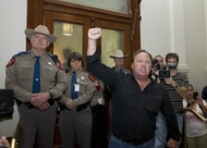 Department of Public Safety troopers block the door to the Senate gallery as activist Alex Jones incites a crowd protesting HB1937 the TSA anti-groping bill on May 25, 2011.