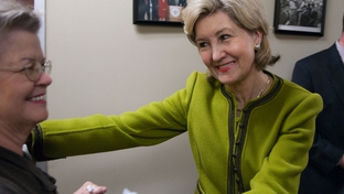 U.S. Sen Kay Bailey Hutchison with a supporter after filing for Texas governor on Dec. 7, 2009