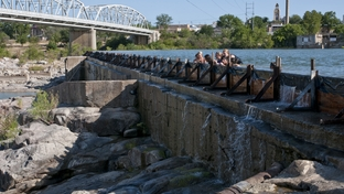 Children in Llano, Texas, can still swim in the town reservoir but due to low water levels can no longer jump off the dam.