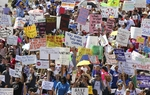 Thousands of Texans march to the Texas Capitol to protest school funding cuts on March 12, 2011