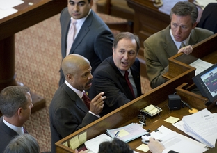 State Rep. Borris Miles (l), D-Houston, raises a point of order on HB400 the education bill sponsored by State Rep. Rob Eissler (r), R-The Woodlands, on April 26, 2011.
