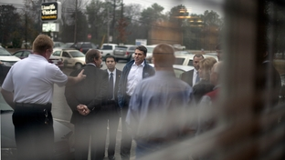 Republican presidential candidate, Texas Gov. Rick Perry greets supporters as he arrives for a campaign stop at Lizard's Thicket restaurant, Wednesday, Jan. 11, 2012, in Lexington, S.C.