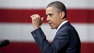 President Barack Obama gestures to the audience at a fundraiser at Austin City Limits Live on May 10, 2011.