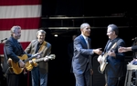President Barack Obama (r) shakes hands with Robert Earl Keen's (far left) band following his speech to supporters at Austin City Limits Live venue on May 10, 2011.