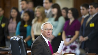 Sen. Steve Ogden, R-Bryan, chairman of Senate Finance Committee, looks for support on the Senate floor during the introduction of the Luna Scholars in the background on May 4, 2011.