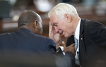 Sen. Steve Ogden, R-Bryan, reacts while talking with Rep. Sylvester Turner, D-Houston, on the Senate floor on April 19, 2011.