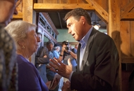 Candidate Rick Perry, r, speaks to a woman one on one after his campaign stop in Orange City, Iowa on October 8, 2011.