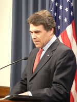Governor Rick Perry at the podium in his press conference room