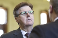 State Sen. Dan Patrick, R-Houston, speaks to an aide on the Senate floor on May 16, 2011.