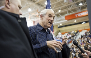 Ron Paul leaving the stage at a Rock the Caucus event at Valley High School in Des Moines, Iowa, on Jan. 3, 2012.