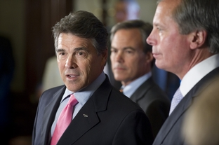 Gov. Rick Perry speaking to reporters alongside House Speaker Joe Straus, center, and Lt. Gov. David Dewhurst during a post-session press conference at the Texas Capitol on May 30, 2011.