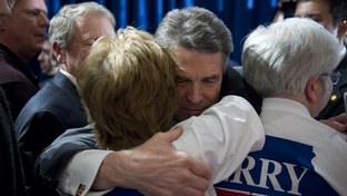 Rick Perry hugs a campaign worker after announcing he's headed back to Texas to reassess his campaign after finishing fifth in the Iowa caucuses on January 3, 2012.