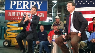 Gov. Rick Perry and Kansas Gov. Sam Brownback in Bettendorf, Iowa, for Perry's government reform speech.