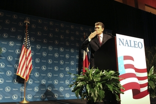 Texas Gov. Rick Perry blows a kiss to his Secretary of State Hope Andrade (not shown) during his speech to the National Assn. of Latino Elected Officials (NALEO) in San Antonio on June 23, 2011.