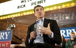 Rick Perry answers a question at the end of a campaign rally in Oskaloosa, Iowa on December 28, 2011.