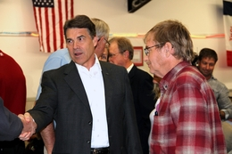 Texas Gov. Rick Perry greets an Iowa voter at a GOP event in Greene County.