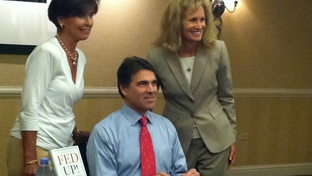 Perry signs books and poses for photos in Denver at Western