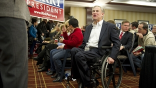 "Texas Attorney General Greg Abbott on Jan. 3, 2012, greeting members of the Texas ""strike force"" in Iowa to support Gov. Rick Perry's presidential bid."