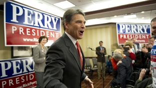 Gov. Rick Perry rallying supporters in an early morning gathering of his team of Texas volunteers on Jan. 3, 2012.