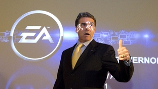 Gov. Rick Perry walks in front of a projection screen at BioWare Corp. EA Games after making an economic development announcement on July 18, 2011.