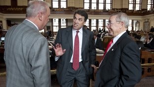 Gov. Rick Perry (c) visits the Texas House and talks to Rep. Gary Elkins (l), R-Houston and Rep. Warren Chisum, R-Pampa, on April 26, 2011.