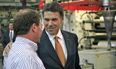 Rick Perry meets with a worker in a South Carolina plastics plant before delivering his flat tax speech.