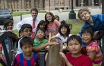 Texas Governor Rick Perry poses with schoolchildren outside the Texas Captiol prior to returning to his office on April 19, 2011.