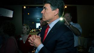 Gov. Rick Perry on May 29, 2012, watching television returns after speaking at the party for Charles Schwertner's victory in the Texas Senate race for District 5.
