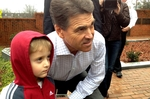 Gov. Rick Perry on the campaign trail with Gavin Stanley, 4.