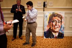 A painting of Ronald Reagan sits off to the side as New Jersey Gov. Chris Christie speaks to the Michigan delegation at the Republican National Convention in Tampa, Florida, August 28, 2012.