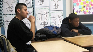 Students Arturo Garcia and Chris Conway listen to a U.S. Department of Education representative describe a grant program targeting low-performing schools like theirs, Reagan High School in East Austin. The money is tied to major overhauls and replacement of staff.