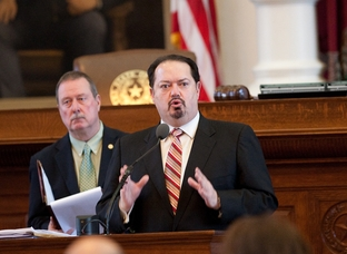 Rep. Rene Oliveira D-Brownsville votes during on amendment during eminent domain debate in house on April 13th, 2011