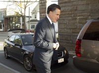 Mitt Romney arrives at a debate site in Hanover, N.H., on Oct. 11, 2011.