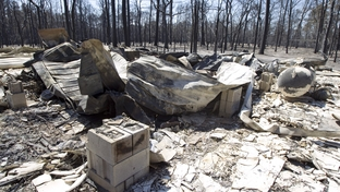 The rubble of a house remains after last weeks' wildfire remains untouched on September 9, 2011.