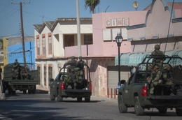 Soldiers ride on a street in Miguel Aleman, a city in the Mexican state of Tamaulipas, in 2010.