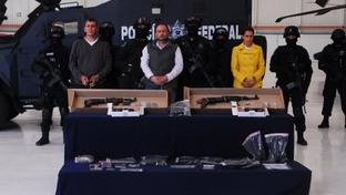 Alleged hit man Arturo Gallegos Castrellon, center, is displayed by Mexican law enforcement.