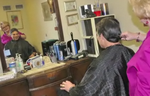Gov. Rick Perry getting his hair cut.