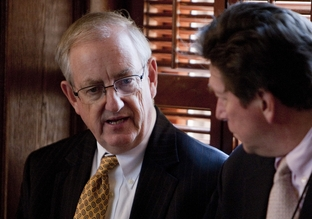 State Rep. John Smithee (l), R-Amarillo, discuss the Texas Windstorm Insurance Assn. bills with a reporter off the House floor on June 27, 2011.