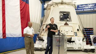 SpaceX CEP Elon Musk, right, shows his delight on the return of the Dragon spacecraft as NASA chief Charles Bolden, left, listens on June 13, 2012.  SpaceX is considering building a spaceport in south Texas for future launches.