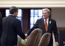 House Speaker Joe Straus (l) shakes the hand of State Rep. Jim Pitts (r), R-Waxahachie, after the House passed HB1 the state budget, 97-53 late on May 28, 2011.