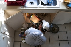 Contractors hired by Austin Energy weatherize a South Austin home with funding from the federal stimulus program.