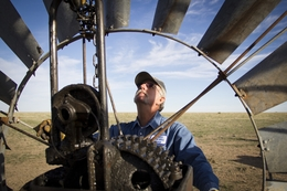 Mike Crowell, a third-generation windmiller, works on a windmill near Claude in the Texas Panhandle.