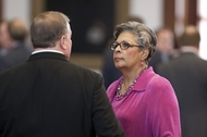 Rep. Senfronia Thompson (r), D-Houston, talks to Rep. Mike Hamilton during the local and consent calendar on April 26, 2011.