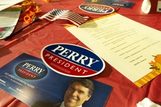 Campaign materials for Gov. Rick Perry at the Johnson County Fall BBQ event in Tiffin, Iowa, where Perry spoke on Oct. 7, 2011.