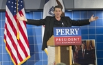 Presidential candidate Rick Perry gestures while giving a speech to the Johnson County Republican BBQ in Tiffin Iowa on October 7, 2011.