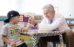 Pediatric oncologist Dr. Kenneth McClain playfully arm-wrestles with patient Isiah Trujillo on Monday, April 25, 2011, at Texas Children's Hospital's Clinical Care Center in Houston, Texas.